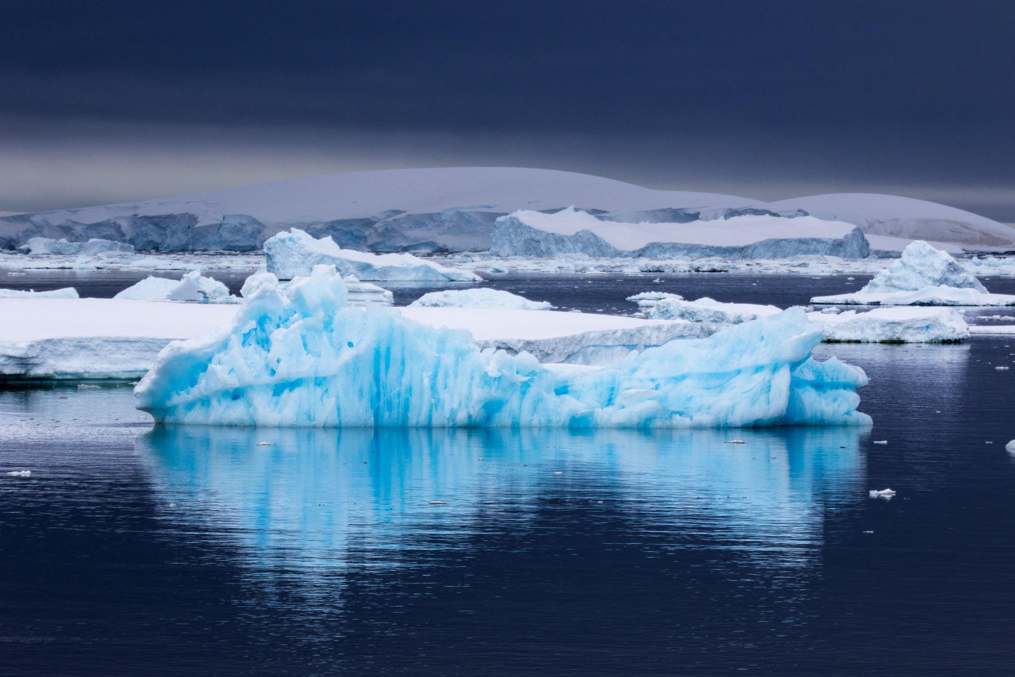 Iceberg bit blue Antarctica
