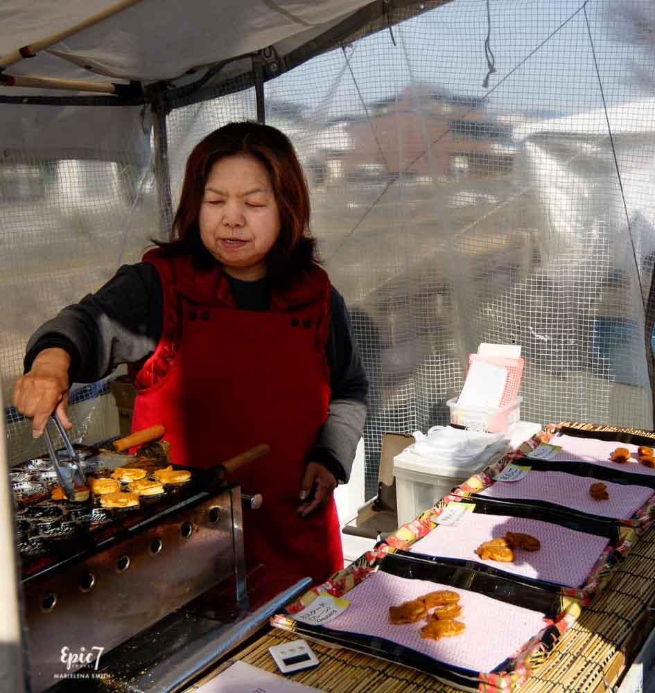 Japan Guide Takayama Miyagawa market  Vendor cooking Taiyaki