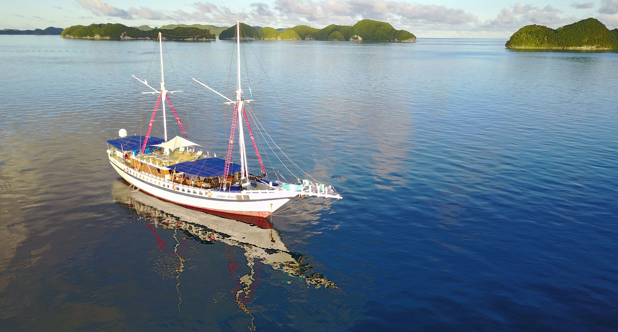 Palau Siren Liveaboard Dive boat anchored amongst Palau Rock Islands