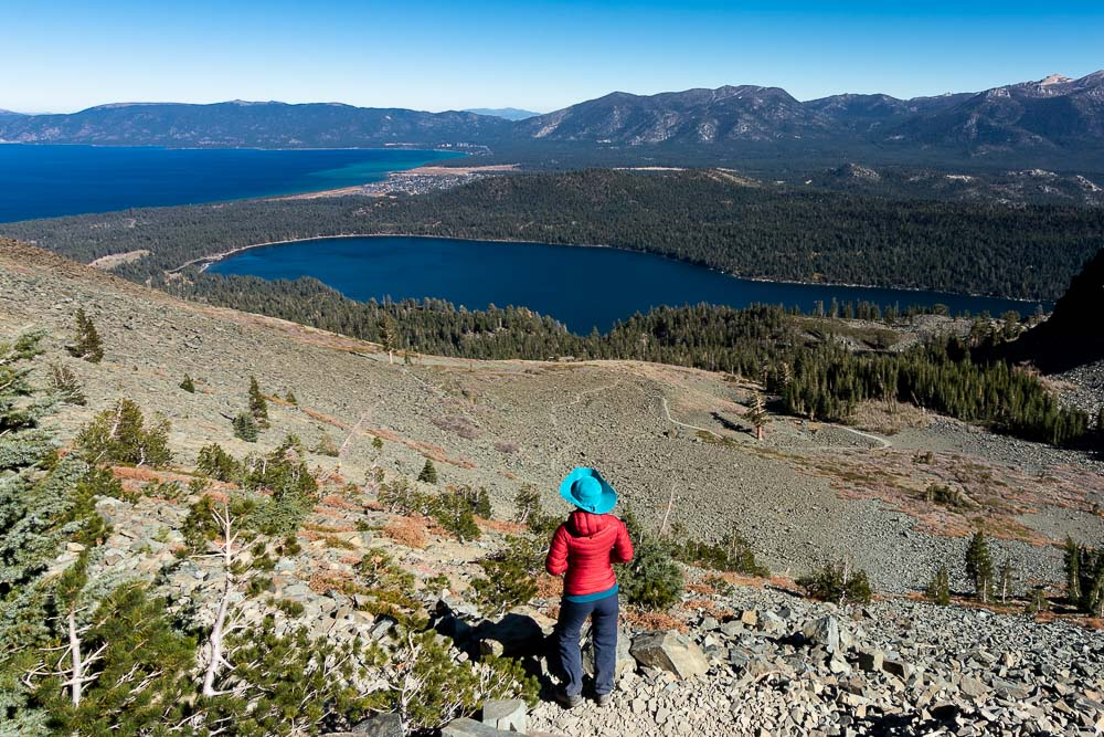 Hiker on Mt Tallac Hike looking at Fallen Leaf Lake and Lake Tahoe