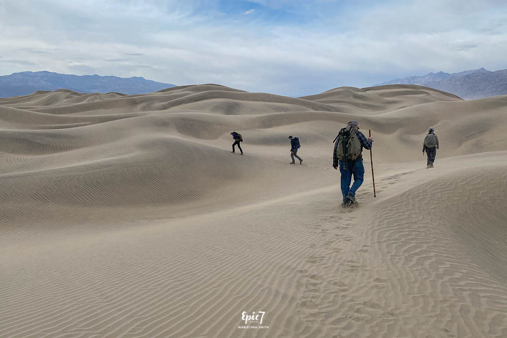 Hikers heading into the Mesquite Dunes in Death Valley